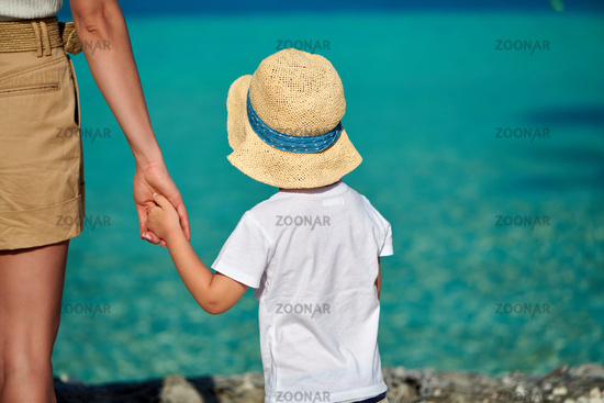 Toddler boy on beach with mother