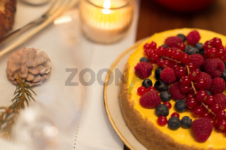 close up of berry cake on christmas table at home