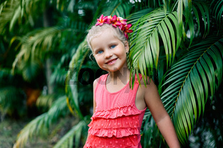 Cute smiling little girl portrait on summer day in the street