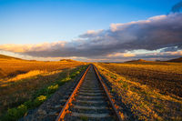 Single railway track at sunset, Czech Republic.