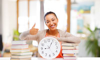 african american student with clock and books
