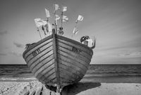 Fishing boat pulled to the beach. . .
