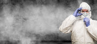 Man Wearing Hazmat Suit and Goggles In Smokey Room Banner with Copy Space