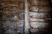 Timber details of wall of old hut
