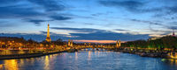 Paris France panorama city skyline night at Seine River with Pont Alexandre III bridge and Eiffel To
