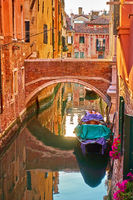 Canal with small bridge in Venice