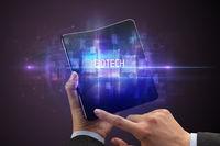 Businessman holding a foldable smartphone