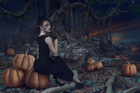 Design of Halloween woman sitting in dark mystic forest at night time