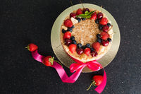 cake with berries on table