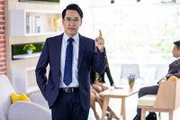 asian businessman point finger up