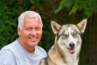 Portrait of dutch man with husky dog
