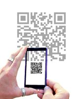 View over the mobile phone screen during scanning QR code isolated on white background. Hands holdin