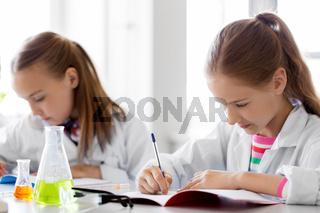 kids studying chemistry at school laboratory