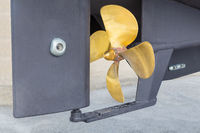 Golden metal propeller and rudder of boat