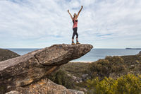 Hiker in national park arms outstretched feel on top of the world