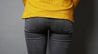 female butt or bottom wearing black denim jeans
