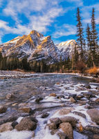 Mount Kidd, a mountain in Kananaskis in the Canadian Rocky Mountains, Alberta and the Kananaskis River in winter