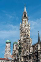 The towers of the New City Hall and the famous Frauenkirche at the Marienplatz in Munich on a sunny