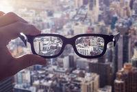 Hand glasses cityscape