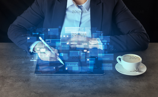 Business woman working on tablet with global database concept