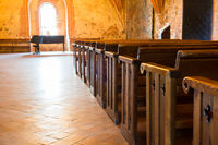 Row of empty seats in church