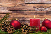 Christmas decoration with candle and pine cones