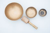 Flat lay composition of wholistic healing Tibetan singing bowls