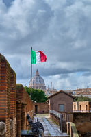 St. Peter's cathedral and flag of Italy in Rome