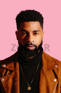 Portrait of a handsome man with beard a isolated on pink studio background