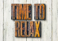 Antique letterpress wood type printing blocks on a white backgound - Time to relax
