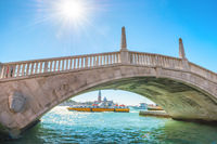Bridge over canal and exit to bay in Venice