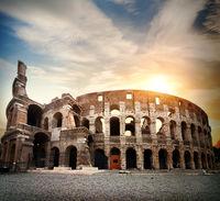 Bright sun and Colosseum
