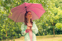 Young girl holding umbrella