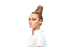 Beautiful spectacular blonde lady with an unusual high hairdo with big blue eyes on a white background