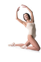 Graceful girl on pointe on the floor isolated view