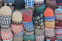 Background from different stacked knitted hats.