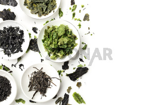 Dry seaweed, sea vegetables, shot from the top on a white background with copy space, a design template with a flat lay composition and a place for text