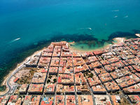 Aerial photography drone point of view Torrevieja resort spanish city from above. Idyllic turquoise bay of Mediterranean seascape, typical residential coastal houses rooftops. Costa Blanca, Spain
