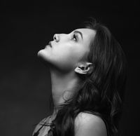 Dramatic black and white portrait of a beautiful girl on a dark background