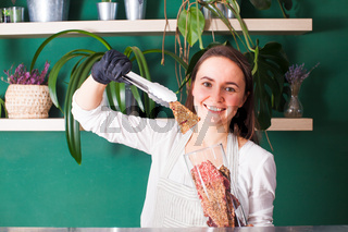 Young woman sells dehydrated raw vegan dry breads