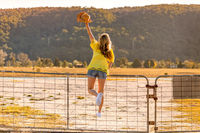 Aussie woman standing on a rural farm gate
