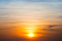 Orange dramatic sunset as background