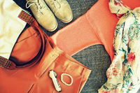 Autumn female outfit. Set of clothes, shoes and accessories on grey background
