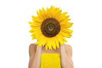 Beautiful young woman with sunflower in her hands isolated on white background