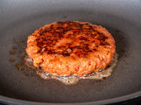 Cooked and ready to eat Lightlife plant based burger being fried in frying pan