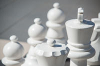 big white chess made of plastic. Selective focus macro shot with shallow DOF