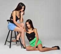 Two beautiful women in summer dresses.
