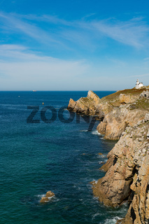 the Toulinguet lighthouse on the jagged rocky coastline of western Brittany