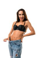 Happy girl in black bra and jeans isolated shot