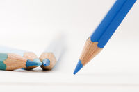 blue colored pencils on paper ground